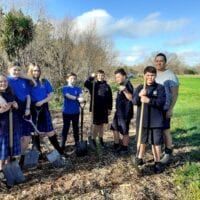 Lakeview School students with Joseph Potangaroa at the Waipoua River