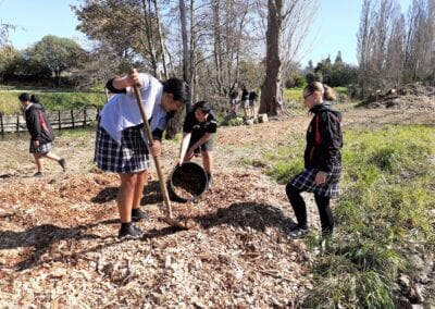 Makoura College students getting stuck into mulching Waipoua River plantings
